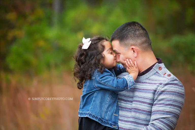 daddy and daughter during an outdoor photography session by Douglasville family photographer