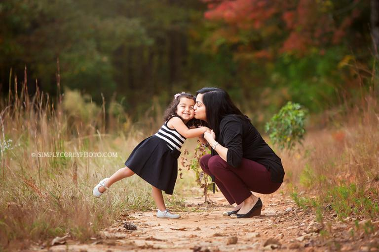 mommy and toddler during an outdoor photography session by Atlanta family photographer