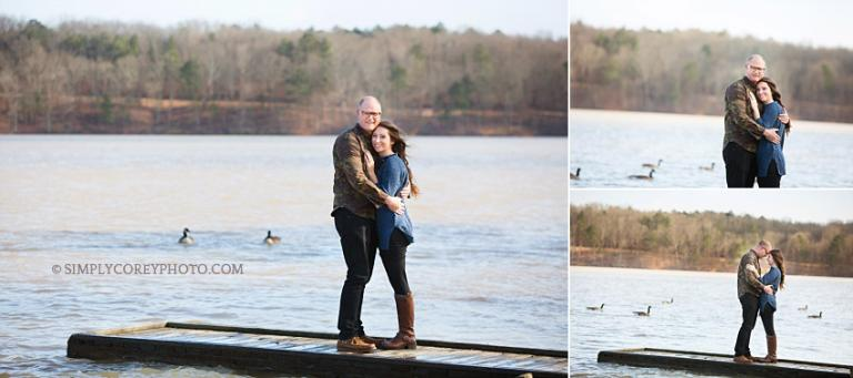 engaged couple on a dock by Douglasville engagement photographer