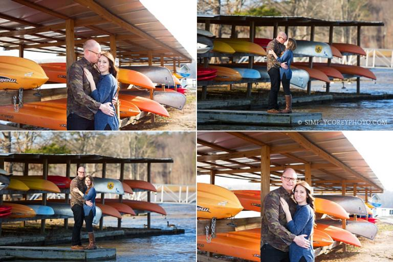 engaged couple with kayaks by Carrollton engagement photographer