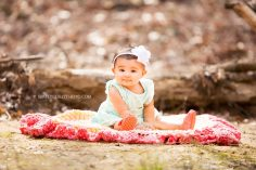 baby girl on a blanket during an outdoor photography session by Atlanta baby photographer