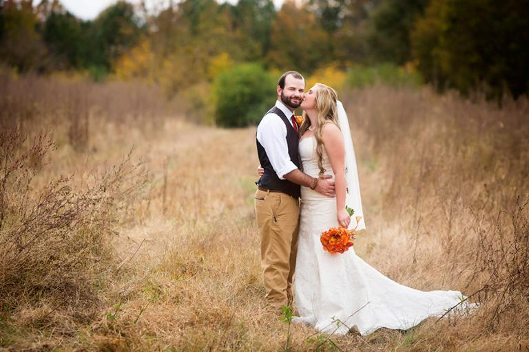 bride and groom in a field at Foxwoods by Atlanta wedding photographer