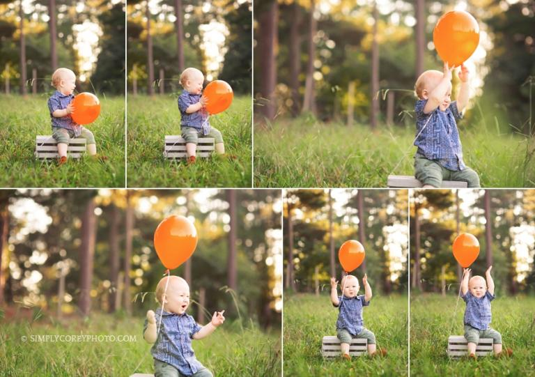 boy with a balloon during an outdoor one year photography session by Atlanta baby photographer