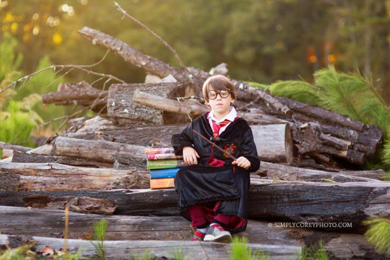 magical Harry Potter themed portraits with books by Atlanta child photographer