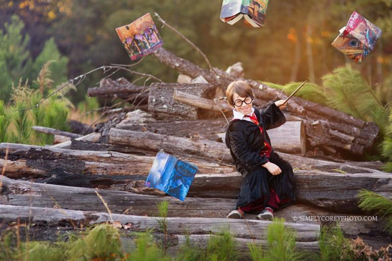 magical Harry Potter themed portraits with wand and books by Atlanta child photographer