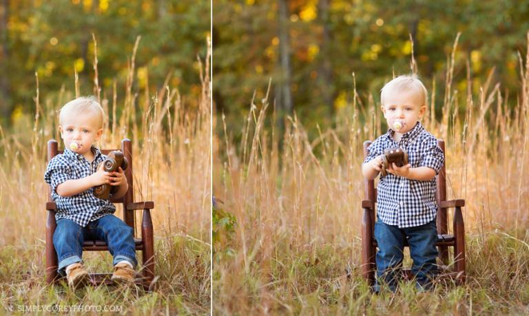 toddler in a field by Carrollton baby photographer