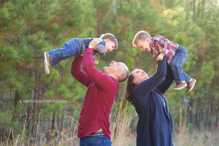 parents playing with their boys outside by Douglasville family photographer
