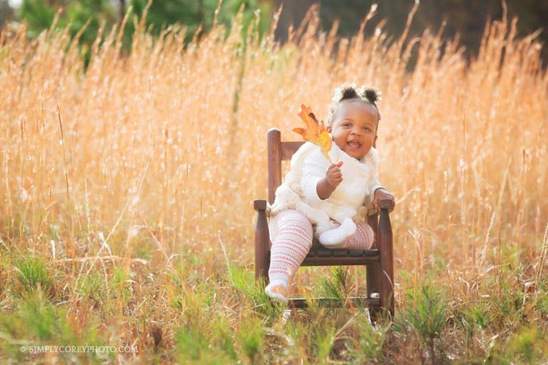 fall portrait of a toddler in a rocking chair by Douglasville baby photographer
