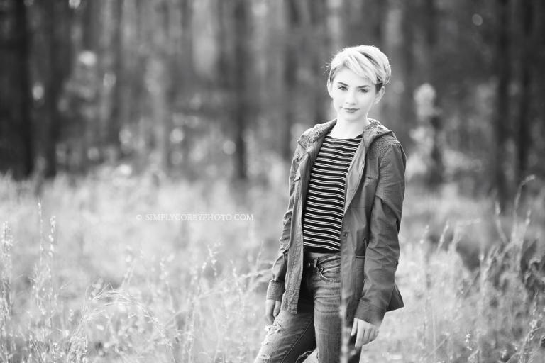 black and white photo of a teen girl in a field by Douglasville model photographer