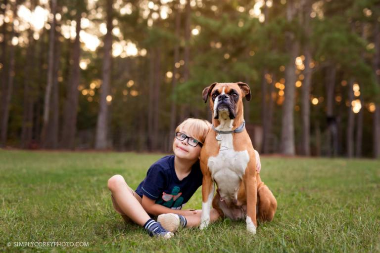 boy and boxer dog in yard by Newnan lifestyle photographer
