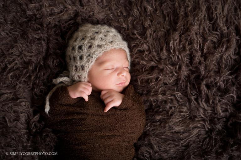 baby boy in brown hat by Carrollton newborn photographer