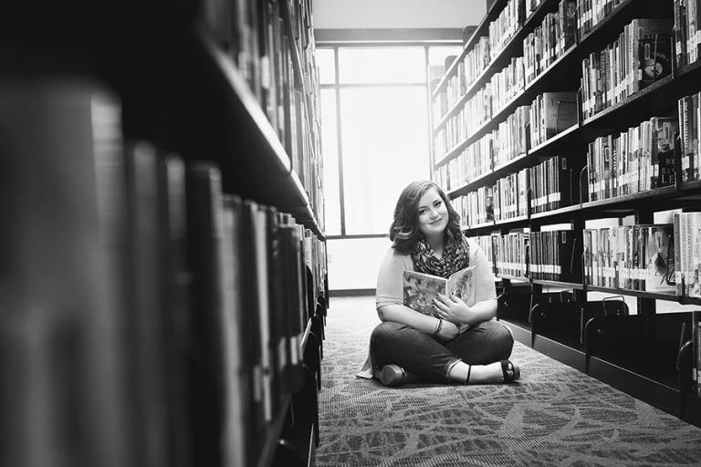 Atlanta senior portraits, teen girl in a library with books
