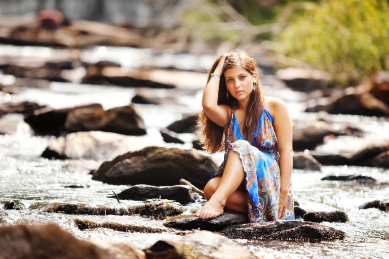 senior portrait photographer Atlanta, teen girl on rocks in water
