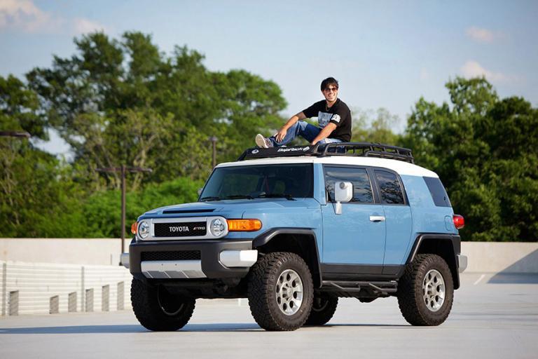 Carrollton senior portraits, teen boy on top of a Toyota vehicle