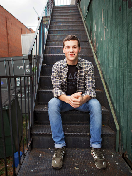 Newnan senior portrait photography, teen boy on downtown stairs