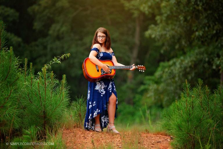 senior portrait photographer near Carrollton, GA, teen girl outside with guitar