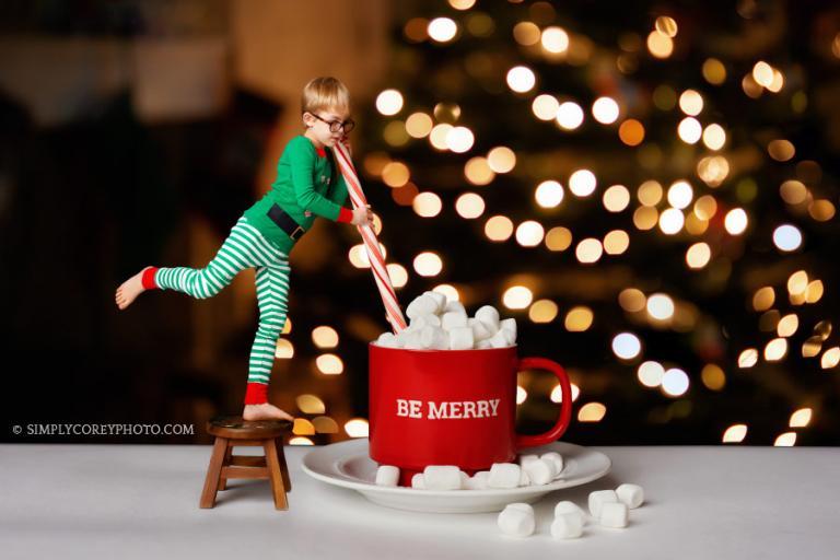 Atlanta photographer, creative holiday photography of a boy as an elf with a cocoa mug