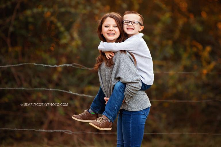 Newnan family photographer, fun sibling portrait outside
