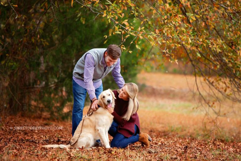 Newnan family photographer, couple outside with pet Golden Retriever