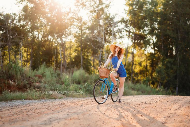 Atlanta senior portrait photographer, teen in floppy hat on a vintage bicycle