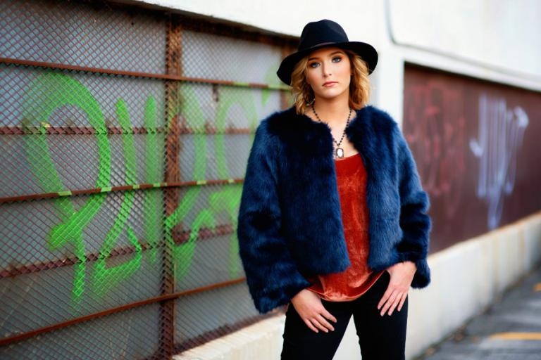 Atlanta senior portrait photographer, teen girl in hat by graffiti wall