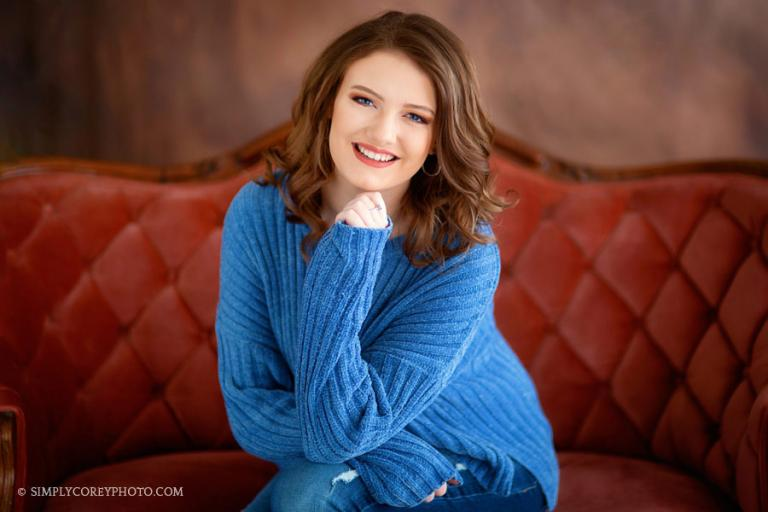 Carrollton senior portrait photographer, teen girl on a couch in studio