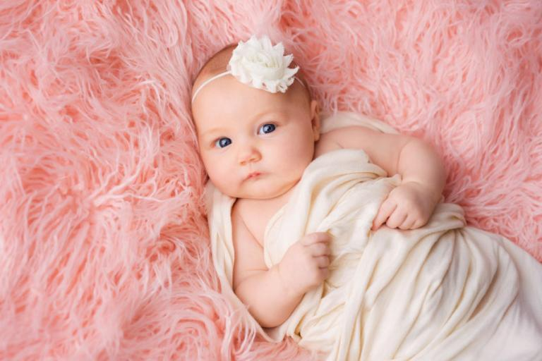 baby photographer Newnan, girl laying on pink fur