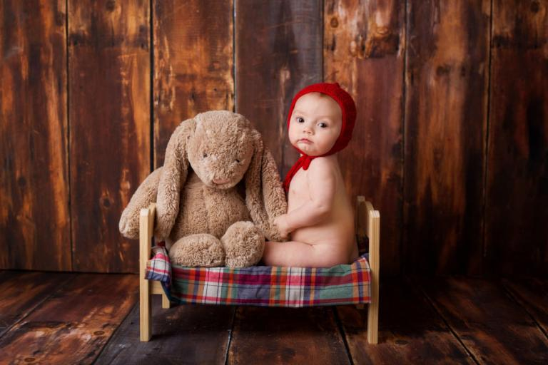 Carrollton baby photographer, boy with a bunny on a bed in studio