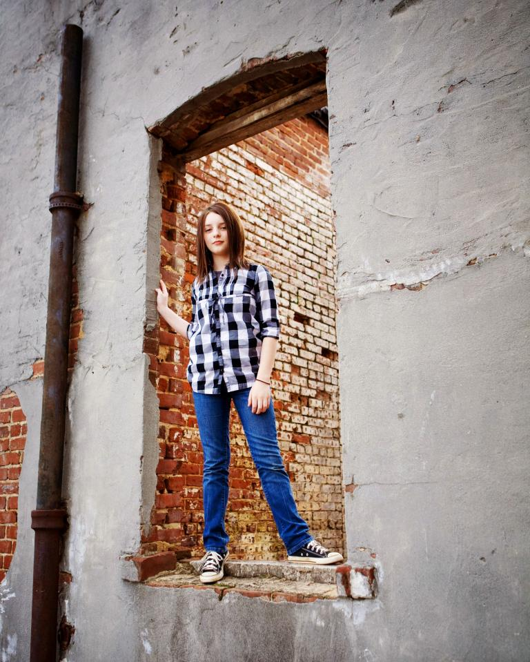 Douglasville children's photographer, girl in an old window downtown