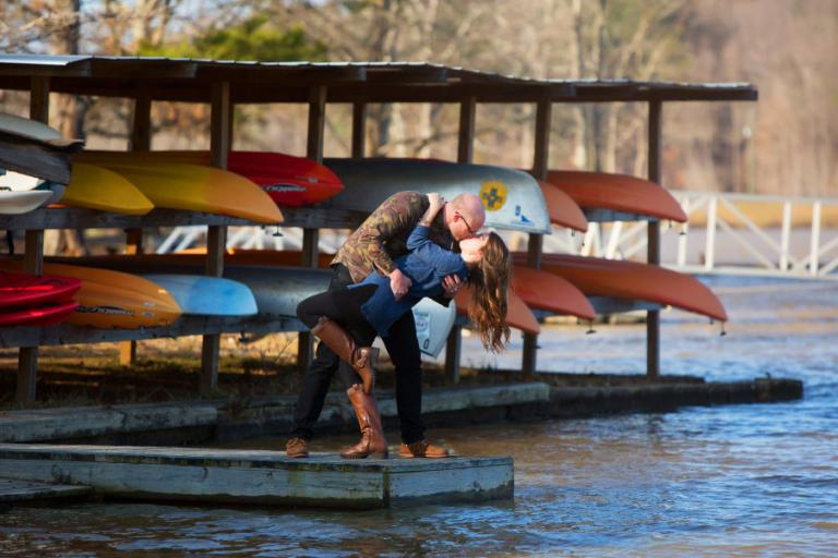 engagement photographer Atlanta, couple on dock with kayaks