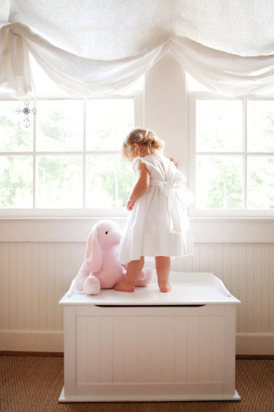 Newnan baby photographer, girl with a pink bunny near a window