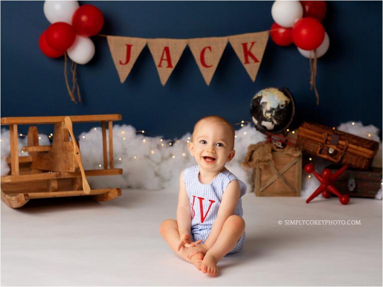 Douglasville baby photographer, boy in monogrammed jon jon in studio