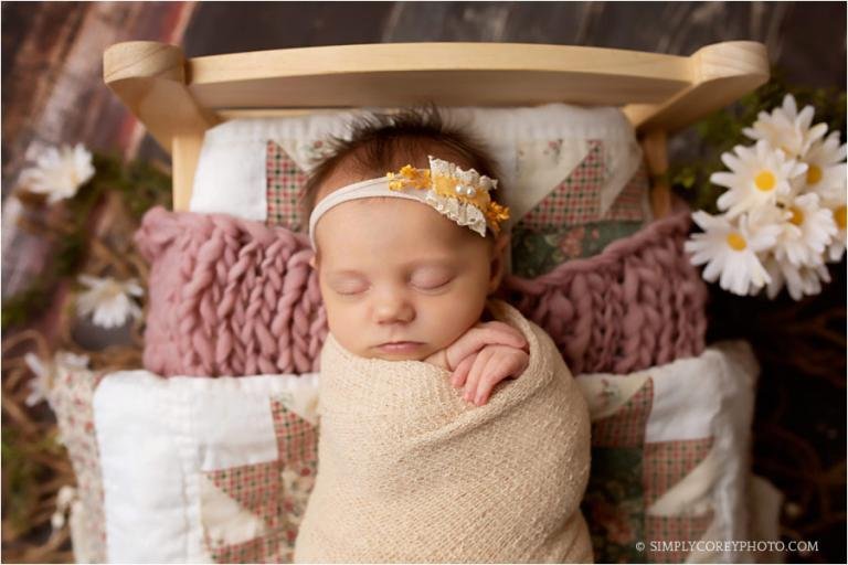 Atlanta newborn photographer, baby girl with quilts on a bed