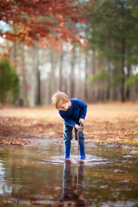 boy playing in a puddle by Atlanta children's photographer