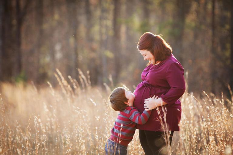 Atlanta maternity photographer, mom and child in a field with tall grass