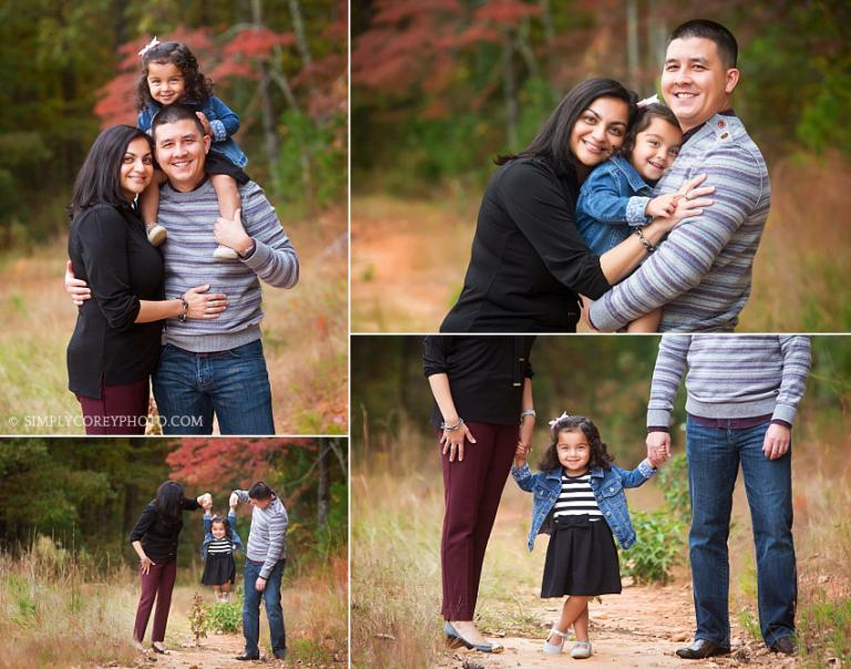 mom and dad with a toddler during an outdoor photography session by Atlanta family photographer