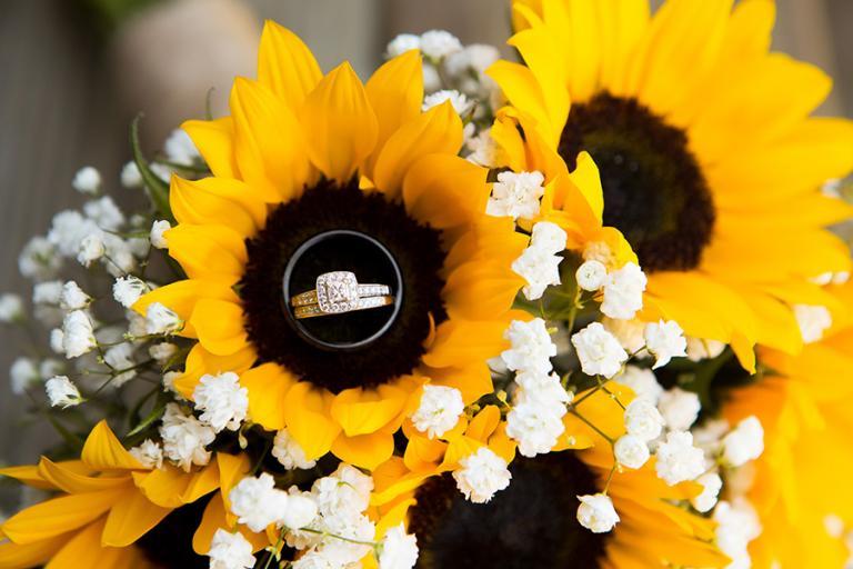 wedding rings in a sunflower buoquet by Atlanta wedding photographer