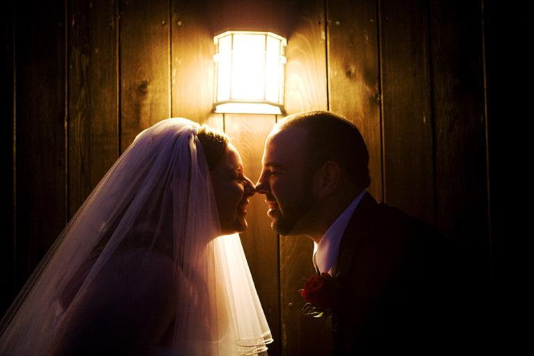 bride and groom under a light by Marietta wedding photographer