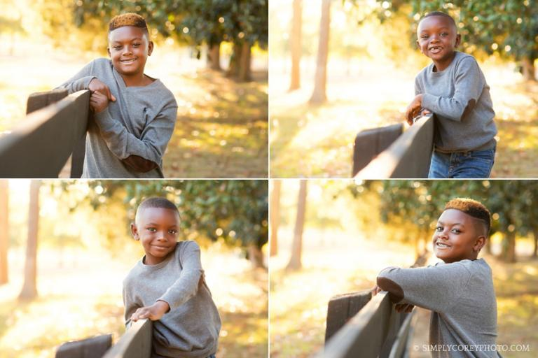 brothers by a fence at Berry College by Atlanta children's photographer