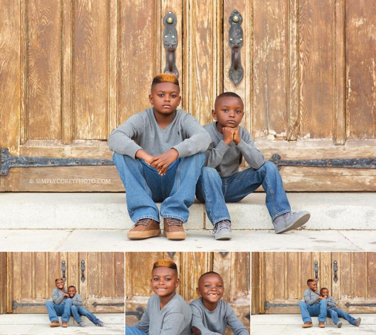 brothers by wooden doors at Berry College by Atlanta children's photographer