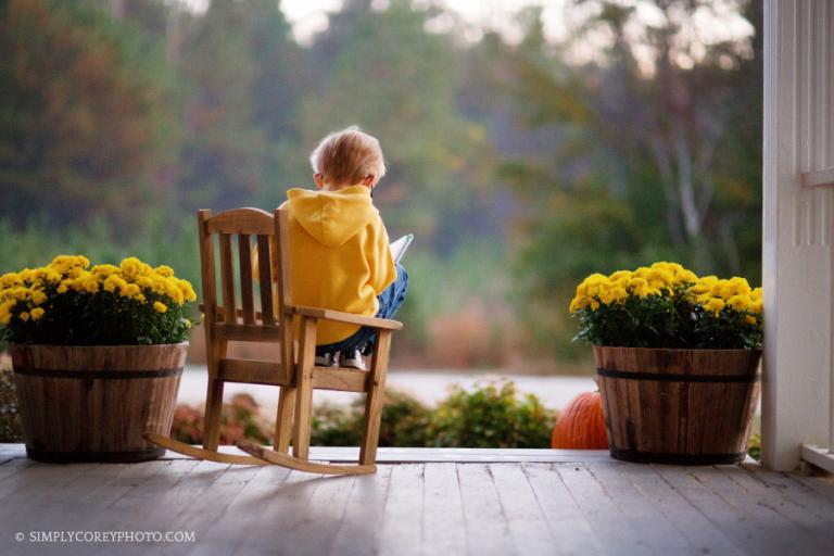 boy reading on front porch by Atlanta lifestyle photographer
