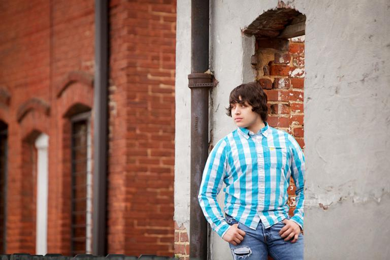 Newnan senior portrait photographer, teen boy downtown