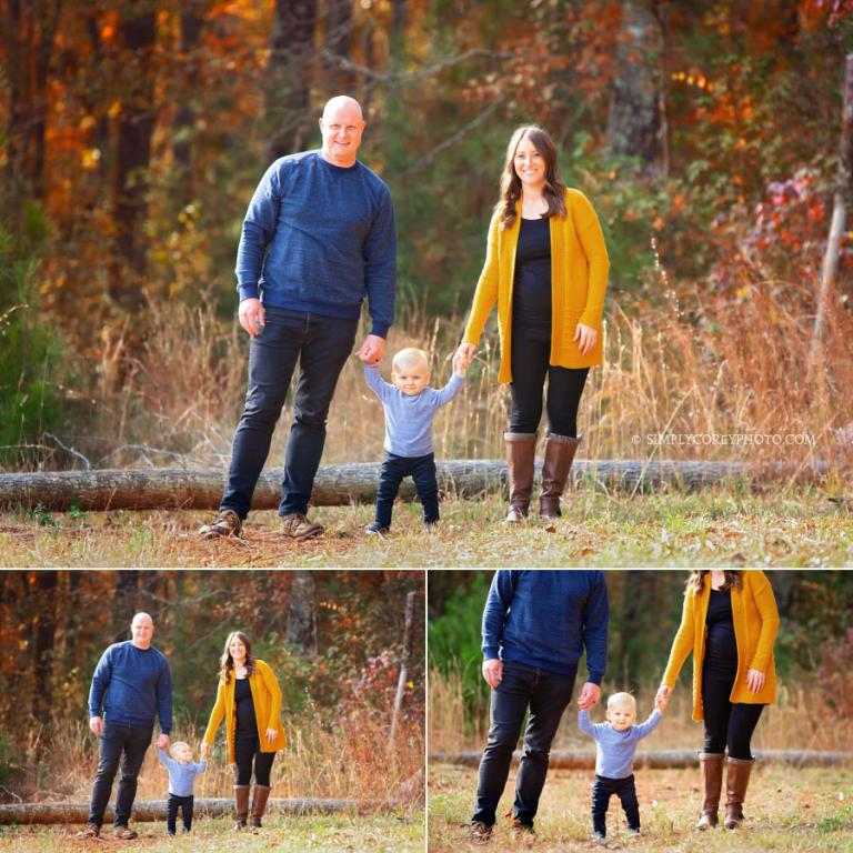 Carrollton family photographer, parents holding baby's hands outside