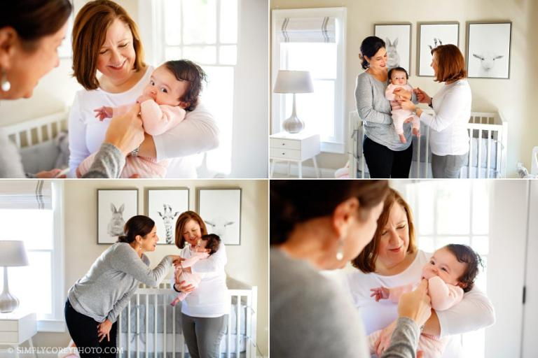 Douglasville family photographer, parents holding baby in nursery