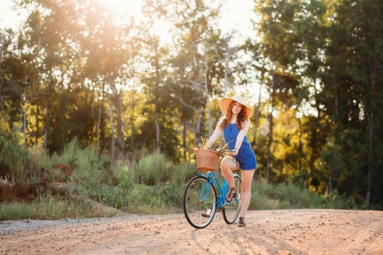 Douglasville senior portrait photographer, teen in floppy hat with a vintage bike