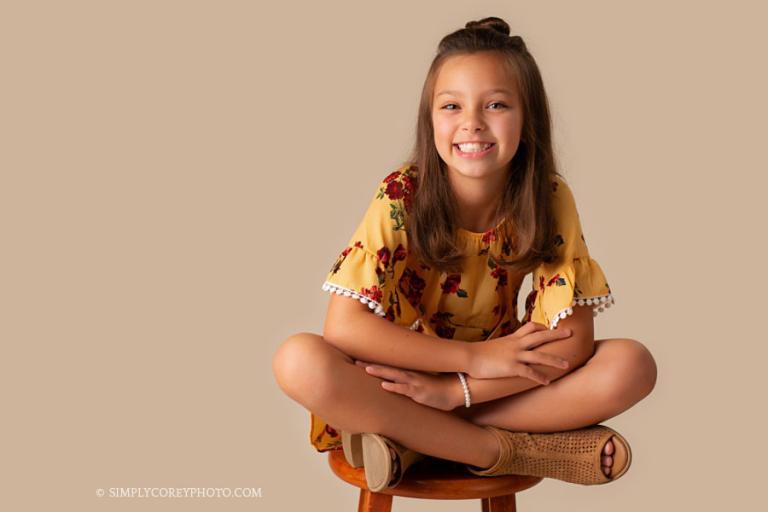 Douglasville children's photographer, child sitting on a stool in studio