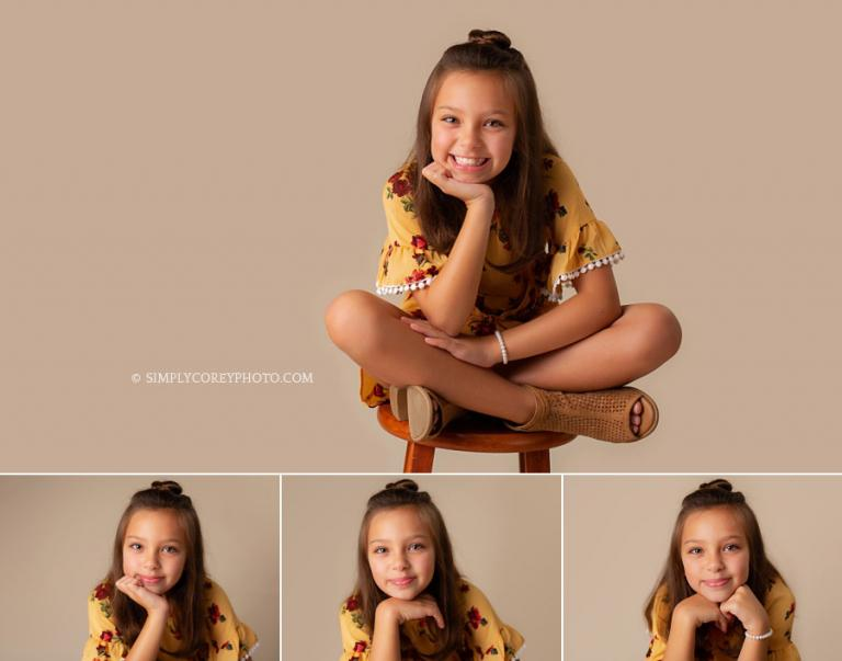 Newnan children's photographer, studio portraits of a girl with a top knot