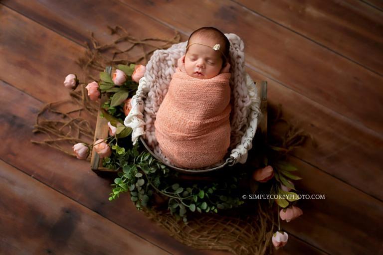 Atlanta newborn photographer, baby girl in pink wrap with flowers