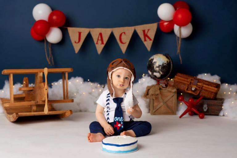 Atlanta cake smash photographer, baby with airplane and aviator hat