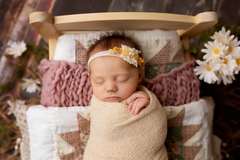 Atlanta newborn photographer, baby girl in a bed with daisies